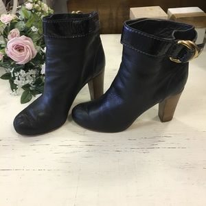 Chloe short black leather boots with gold buckle